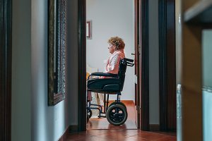 Lonely old woman in wheelchair