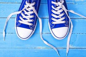 pair of blue textile shoes