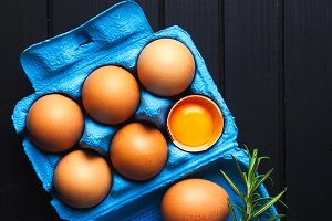 eggs in a blue paper container. yolk