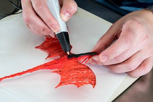 3-D printing pen creating a dragon shape