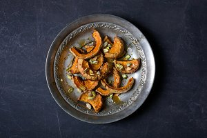 Baked pumpkin with pistachios and honey