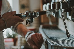 Espresso machine pouring coffee