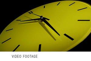 Yellow clock. Time lapse.
