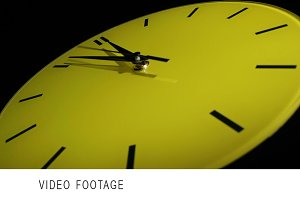 Yellow clock. Slow time lapse.
