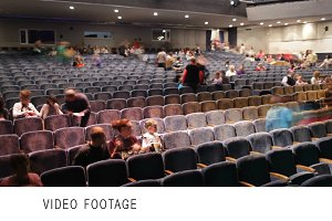 Audience fills the theatre.
