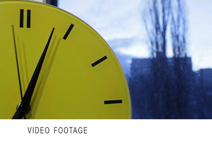Yellow clock. Time lapse. - Arts & Entertainment