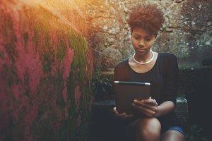 Black girl with digital tablet