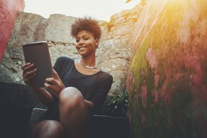 Black happy girl with digital tablet
