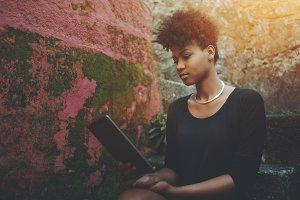 Portrait of black girl, tablet pc