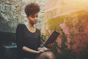 Black girl using digital tablet