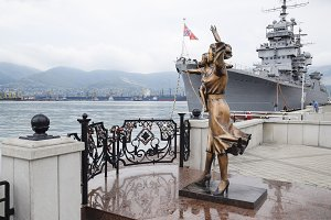 Monument to sailor's wife. Warship Admiral Kutuzov. The area of Novorossiysk Sea Commercial Port.