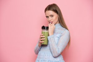 woman drink healthy green smoothie