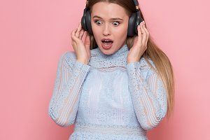 excited girl listen to music