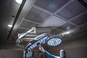 Doctors prepare lamp before operation.