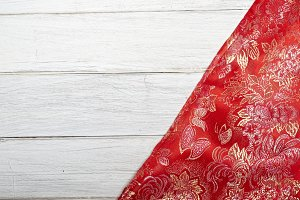 Red silk on old wooden table