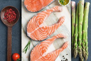 Fresh salmon steaks and herbs