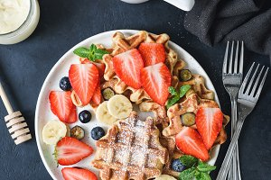 Homemade belgian waffles with fruits