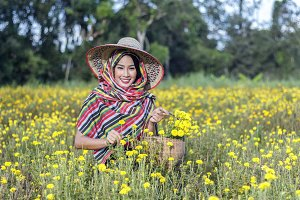 gardener girl in marigold flowers