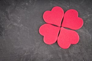 Pink hearts on a gray background. The symbol of the day of lovers. Valentine's Day. Concept February 14.