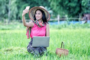 woman selfie in rice field