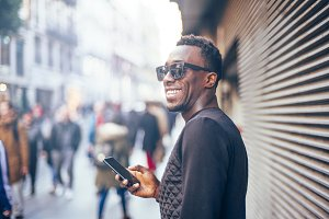 African handsome man with mobile phone.