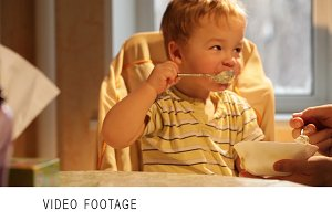 Little boy eats porridge.