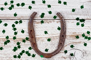 Rusty Horseshoe and Green Clovers