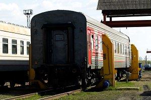 Passenger car on the railway tracks