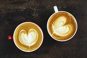 two cups of coffee cappuccino with h