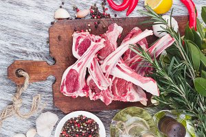Raw lamb chop on the wooden board
