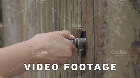 Girl opens a metal gate, Georgia
