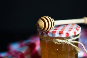 Orgaic honey on rustic table