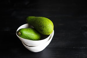 Organic avocados on rustic table