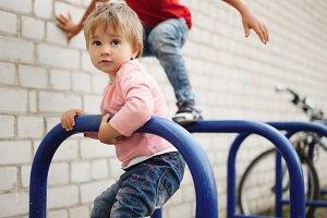 boy and girl climb on bike parking