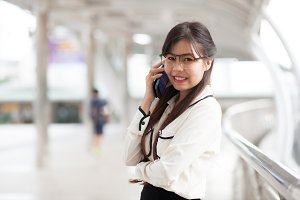 Smile businesswoman talking phone.