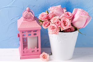 Pink roses flowers and lantern