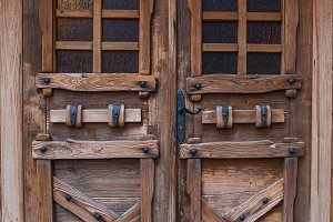 wooden doors with iron forging
