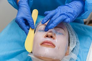 woman in mask cosmetic procedure