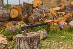 Ax against the background of firewood
