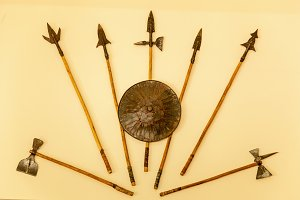 weapons of a warrior, spears, axes, shield.