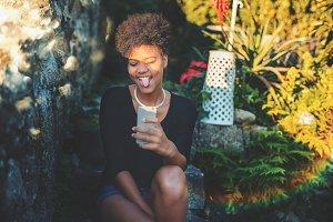 Black girl is aping during selfie