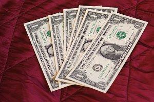 One Dollar notes, United States over red velvet background