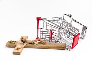 Shopping cart overturned with crucif