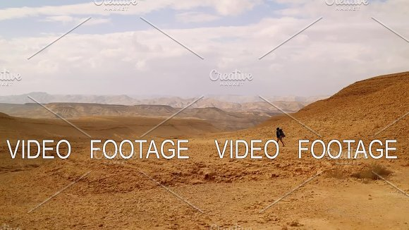 african american young man Traveler with Hiking backpack walk in desert