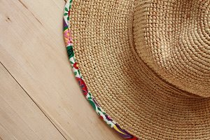 Straw Sun Hat with Wood Background