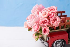 Retro car with pink roses flowers