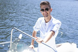young man on the yacht's summer vacation