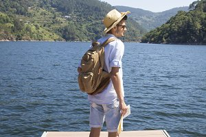 young man with backpack and map, people travel and vacation