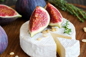 Camembert cheese with fresh figs