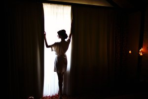 Silhouette of bride girl in the morn
